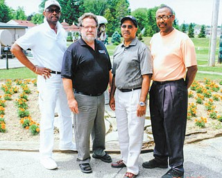 Youngstown Golf Club members are kicking off an annual golf outing in memory of Dr. Earnest Perry to provide scholarships to medical students. Those involved are, from left to right, George Ross, president of Youngstown Golf Club; John Russo, a professor at Youngstown State University; George Williams, owner of Goldie's Flowers; and Phil Smith of Choice Homes.