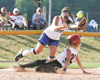 Canfi eld outfi elder Allie Samarco safely steals third base as Poland third baseman Gina Ungaro fi elds the ball during the bottom of the second inning Tuesday against the Bulldogs. The Cardinalswon 11-5 to gain the Little League Ohio District 2 championship.
