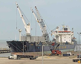 "In this May 19, 2011 photo, steel coils are unloaded from the Polish ship ""Isa"" at the Port of Cleveland. The Commerce Department said Tuesday, July 12, 2011, the deficit increased 15.1 percent to $50.2 billion in May. That's the largest imbalance since October 2008. (AP Photo/Mark Duncan)"