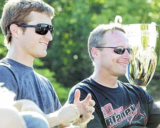 Drivers Kasey Kahne, left, and Dave Blaney smile for fans during Tuesday's Alzheimer's Association benefit night at Sharon Speedway.