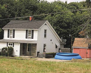 A temporary swimming pool sits in a driveway at a home in the 1200 block of Campbell Street in Youngstown.