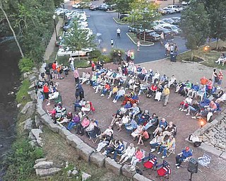 Patrons gather behind the Poland Library on South Main Street on July 8 for the first night of Yellow Creek Theatre, which screens free classic movies every Friday.
