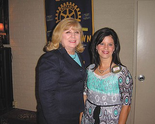 Walk to End Alzheimer's: Helen Paes, left, community development director for the Greater East Ohio Area Chapter of the Alzheimer's Association, spoke recently to the Rotary Club of Austintown, led by President Deanna Spirko, right. Paes discussed the Walk to End Alzheimer's scheduled for Sept. 24 at Courthouse Square in Warren and Oct. 8 at Boardman Park. She said the purpose of the walk is to draw attention to the disease, the sixth leading cause of death in the United States. For more information on the walk or on healthy aging, visit www.alz.org or call 330-533-3300.