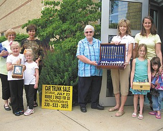 Ursuline Center Car Trunk Sale: More than 70 vendors have signed up for the Ursuline Center's Annual Car Trunk & Treasure Sale, from 8:30 a.m. to 1 p.m. July 23 at the center, 4280 Shields Road, Canfield. The Ursuline Sisters of Youngstown will sell goods inside the center, and a public sale will go on in the parking lot. Food also will be for sale. Attendance is free, indoor rest rooms are available, and security will be on-site. All proceeds will support the ministries of the sisters at the center. Helping Sister Bridget Nolan, Ursuline Motherhouse administrator, center, prepare for the event are, from left, Eileen Novotny, India and Sabrina Gatts, Peggy Eicher, Joan Sonnett, and Amy Finnerty and her daughters Meghan and Abby.