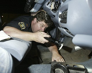 William D. Lewis The Vindicator   Boardman PD Lt. Ed McConnell searches a car after a traffic stiop on Market St, A small amount of maijuana was found in the vehicle.7-6-11.