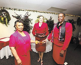 From left to right are Gwen Montgomery, Germaine Bennett and Marcia Haire-Ellis, members of the Youngstown Alumnae Chapter of Delta Sigma Theta Sorority. Montgomery is the new president, Bennett conducted her installation recently, and Haire-Ellis is outgoing president.