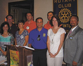 Sworn to serve: Newly elected officers and the board of directors of the Rotary Club of Austintown were sworn in by Rotarian Chuck Baker at the July 11 meeting. In the front row, from left to right, are Deanna Spirko, president; Hillary Prestridge, secretary; Vince Colaluca, vocational service; Jennifer Connolly, international; and Mark Cole, club service. In the back row are Ron Carroll, vice president; Brian Frederick, treasurer; and Dave Buttar, community service.