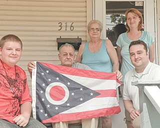 Not forgotten: During the Fourth of July weekend, Columbiana County Recorder Craig Brown met with local war veteran Jonas Murray. Murray is one of the area's last Korean War veterans. He served in the 43rd Infantry and graduated from the Advanced Medical Leaders Academy. From left are Scott Vankirk, Murray's grandson; Murray; his wife, Barbara; Elizabeth Horner, his stepdaughter; and Brown.