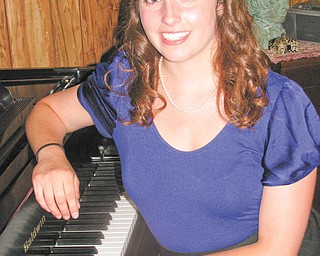 Eva Maria Laino, 19, who has earned numerous awards for her musical accomplishments, recently presented her senior piano recital in Canfield.