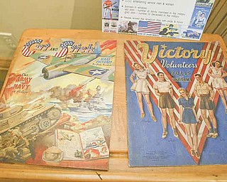 William d Lewis the Vindicator  Childrens cutout books from WWII on display at the Barnhisel House in Girard as part of military uniform exhibit.7-18-11.