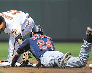 Cleveland Indians' Grady Sizemore (24) slides into second with a double in front of Baltimore Orioles second baseman Robert Andino (11) during the first inning of a baseball game, Sunday, July 17, 2011, in Baltimore. Sizemore left the game with an injury on the play. (AP Photo/Nick Wass)