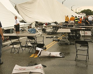 ROBERT K. YOSAY | THE VINDICATOR..A late afternoon summer thunderstorm hit the southside of Youngstown - taking down limbs, trees and knocking out electric -  the RIBFEST at the Covelli Centre had several people injured when tents were blown down ...-30-