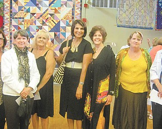 The YWCA's 29th Annual Women Artists: A Celebration art show resulted in awards for some of the artists, including, from left: Sharon Meenachan, Jo Ann Buzulencia, Joyce Garvey, Tazim Jaffer, Salli Kowalski, Catherine Theodore and Kathleen Terlecky.