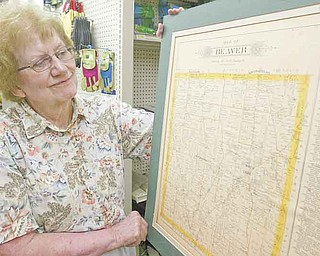 William D. Lewis the Vindicator   Barbara Morey, local historian in Beaver Twp looks over an old township map. The township is about to observe its 200th anniv.