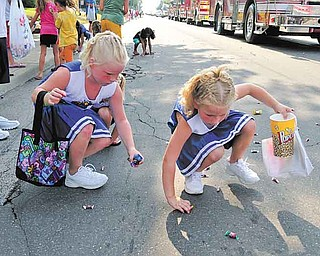 Mikayla Jumper and Mikenzie Jumpber of Hubbard pick up candy during the Family Funday Parade in Hubbard Saturday afternoon.