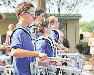 Members of the Hubbard High School drumline march down East Liberty Street in Hubbard during the Family Funday parade.