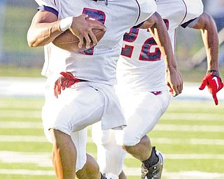 Inseparable since birth, Austintown Fitch High School football standouts and brothers — quarterback Demetrious Davis (3) and wide receiver Chris Davis (22) — are going to continue to play football together at the University of Pittsburgh.