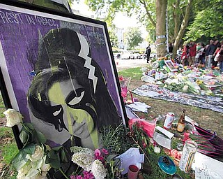 Flowers and tributes left by mourners in Camden Square, outside the house of Amy Winehouse after her death. Mitch Winehouse, Amy Winehouse's father, greeted and thanked mourners Monday for coming to lay bouquets, messages and handwritten notes.