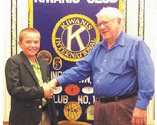 Chuck Whitman, right, president of the Kiwanis Club of Youngstown, greets Brian Terlesky, 11, a world-ranked junior golfer from Boardman, who recently visited the club. Brian recently shared with club members his experiences golfing around the country and the world.