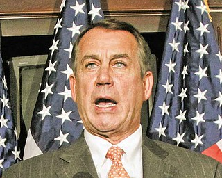 House Speaker John Boehner of Ohio, right, accompanied by Rep. Cathy McMorris Rodgers, R-Wash., gestures while speaking at The Republican National Committee on Capitol Hill in Washington, Tuesday, July 26, 2011.  (AP Photo/Carolyn Kaster)
