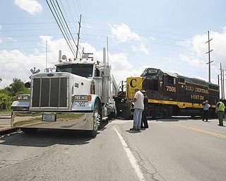 A train hit a tractor-trailer broadside Tuesday afternoon at a crossing at Meridian Road near Vestal Road, blocking the busy intersection for more than 90 minutes. There were no injuries..