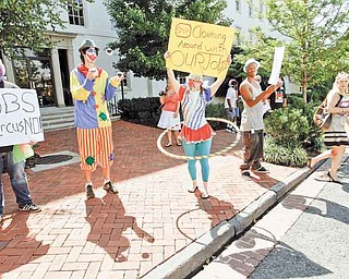 Washington residents, dressed as clowns, take part in a jobs demonstration outside of the Cannon House Office Building on Capitol Hill in Washington Wednesday, July 27, 2011.(AP Photo/Jose Luis Magana)