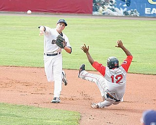 Scrappers infielder Todd Hankins fires to first for a double play as Lowell baserunner Keury De La Cruz (12) hits the dirt during Wednesday's game at Eastwood Field.