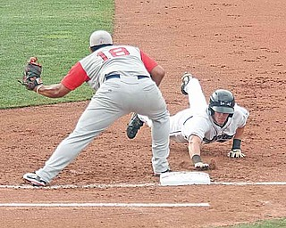 Scrappers baserunner Cody Elliott dives back to first base as Lowell's Boss Moanaroa waits on a throw during the Scrappers' 5-3 win at Eastwood Field.