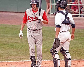 Lowell's Drew Turocy looks for a sign from his third-base coach during Wednesday's game. Tuorcy, a graduate of Canfield High, was drafted by the Boston Red Sox in June's draft.