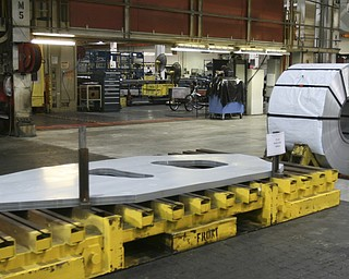 ROBERT  K.  YOSAY    THE VINDICATOR --..From Steel to parts the West Complex takes rolls of steels and fabricates them into Cruze  for the assembly plant..The Lordstown Complex is a General Motors automobile factory in Lordstown, Ohio comprising three facilities: Vehicle Assembly, Metal Center, and Paint Shop. The plant opened in 1966. Lordstown currently builds the global Chevrolet Cruze compact car.The plant welcomed over 9000 visitors to view the  Metal Center ( west plant) and the asembly plant on Thursday.--30-..(AP Photo/The Vindicator, Robert K. Yosay)