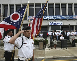 ROBERT  K.  YOSAY    THE VINDICATOR --..John Julio Salutes at opening ceremony at GM Lordstown open house - over 50, 000 dollars was given away from GM endowments to 5 area agencies..The Lordstown Complex is a General Motors automobile factory in Lordstown, Ohio comprising three facilities: Vehicle Assembly, Metal Center, and Paint Shop. The plant opened in 1966. Lordstown currently builds the global Chevrolet Cruze compact car.The plant welcomed over 9000 visitors to view the  Metal Center ( west plant) and the asembly plant on Thursday.--30-..(AP Photo/The Vindicator, Robert K. Yosay)