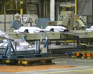 ROBERT  K.  YOSAY    THE VINDICATOR --..Under carriage parts move from a stamping press to be combined with other formed steel to be made at Cruze's  ( we were on trams and could not stop to get names)..The Lordstown Complex is a General Motors automobile factory in Lordstown, Ohio comprising three facilities: Vehicle Assembly, Metal Center, and Paint Shop. The plant opened in 1966. Lordstown currently builds the global Chevrolet Cruze compact car.The plant welcomed over 9000 visitors to view the  Metal Center ( west plant) and the asembly plant on Thursday.--30-..(AP Photo/The Vindicator, Robert K. Yosay)