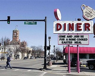 """In this April 8, 2009 photo, Lester's Diner is shown at its location on Main Street in Bryan, Ohio.  The sale of a Lester's Diner includes its iconic sign, which would look familiar to fans of the old TV sitcom """"Alice.""""  Lester's aging owners closed the place in May and put it up for sale. The buyers posted a sign outside this week saying the diner would become part of a regional group of Four Seasons restaurants serving American-Greek food.   (AP Photo/The Blade/Dave Zapotosky)"""