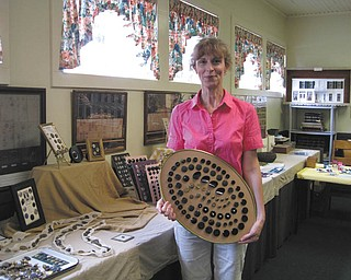 Barb James of Berlin Center shows off her extensive button collection. The collection will be featured at the Heritage Day event from noon to 5 p.m. Aug. 7 at the Ward-Thomas Museum in Niles.