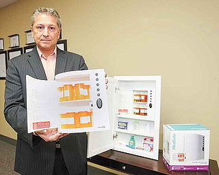 Michael Boccia of Poland displays the medication lockbox he helped create with his childhood friend Michael Rebando.