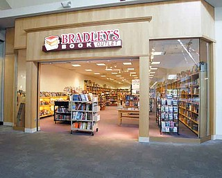 ROBERT K. YOSAY | THE VINDICATOR..Maya Estes - store manager with her lateste arrivals - Borders may be closing, but some independent book stores are thriving, like Bradleys, which recently opened up its first Ohio location in Southern Park Mall. . ..-30-