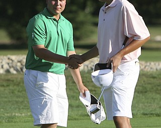 ROBERT  K.  YOSAY  | THE VINDICATOR --..James LaPolla  winner of the tourney shakes the hand of  Dominic Carano  on the 18th hole. -- The Vindicator Greatest Jr. Golfer of the Valley -at Trumbull Country Club in Warren -.--30-..(AP Photo/The Vindicator, Robert K. Yosay)