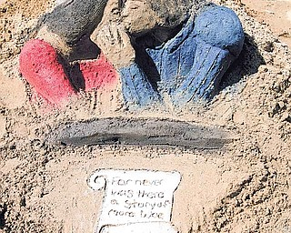 """Serena Kennedy, 15, of Austintown took third place with this """"Romeo and Juliet"""" sculpture at Sunday's Sunfest sculpting competition. Her sister Paisley Kennedy, 21, took second place with a mermaid sculpture."""