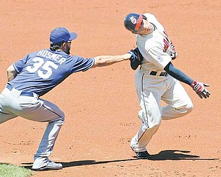 Kansas City Royals first baseman Eric Hosmer, left, tags out Cleveland Indians' Asdrubal Cabrera in the second inning in a baseball game on Sunday in Cleveland. The Royals won 5-3.