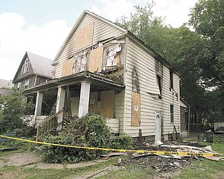 Officials are investigating the cause of the 123 E. Chalmers Ave. fire that killed 83-year-old Patricia Conway. Her son Hilbert Taylor survived TuesdayÕs fire and was taken to an Akron hospital..