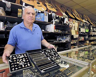 Rick Fine, owner of Sandel's Loan Inc. & Pawn Shop, 306 W. Federal St., said he doesn't think the price of an ounce of gold can climb much higher than its current rate. Gold on Tuesday set another record high.