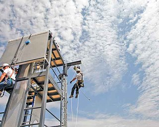 2011 Airstreams is a Tehachapi, California, company that offers safety and rescue courses for wind turbine, oil and gas employees. Students train on a 30-foot mobile tower outside the company's headquarters. Instructor Carl Mosby hangs from the training tower, right, in an exercise designed to train students in repelling techniques. (Michael Robinson Chavez/Los Angeles Times/MCT)