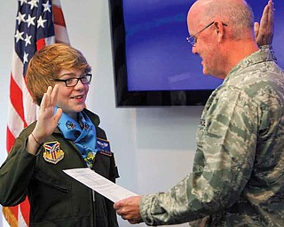 """Lt. Col. Dale C. Andrews swore in Connor Covan, 15, of Boardman, as an honorary Air Force Reserve 2nd lieutenant and """"Pilot for a Day"""" at the 910th Airlift Wing on Wednesday."""
