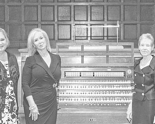 Nick Mays | SPECIAL TO The Vindicator: Committee members for the dual anniversary event for Stambaugh Auditorium and the Youngstown Symphony Orchestra and the dedication of this Skinner pipe organ at the auditorium are, from left, Phil Cannatti, Susan Berny, Jeanne Simeone, Patricia Syak, president and CEO of the Youngstown Symphony Society, and William Conti, president and trustee of Stambaugh.
