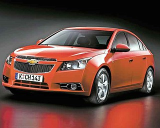 This undated photo provided by General Motors shows a 2011 Chevrolet Cruze. (AP Photo/General Motors)