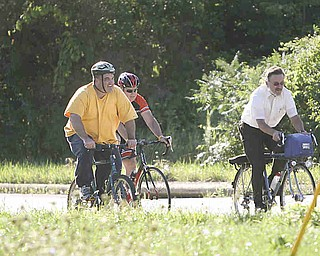 ROBERT K. YOSAY | THE VINDICATOR..Climbing the hill on Hadnet Dr..Ride to work with Franko...Frank Krygowski-- White shirt -- Carl Frost - Orange and Black - Todd Franko in Orange -30-
