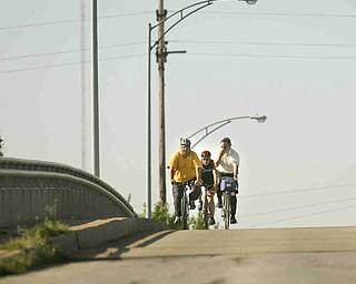 ROBERT K. YOSAY | THE VINDICATOR... Cresting the hill on South Ave Bridge....Ride to work with Franko...Frank Krygowski-- White shirt -- Carl Frost - Orange and Black - Todd Franko in Orange -30-