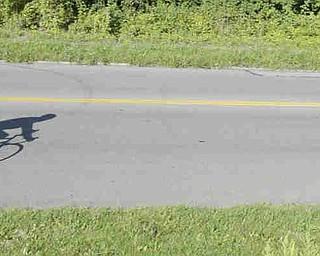 ROBERT K. YOSAY | THE VINDICATOR...Powers way  shadows - .Ride to work with Franko...Frank Krygowski-- White shirt -- Carl Frost - Orange and Black - Todd Franko in Orange -30-