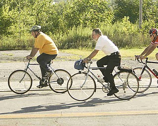 ROBERT K. YOSAY | THE VINDICATOR... Lonely on the road as the crew heads north on Poland Ave.  almost into downtown ..Ride to work with Franko...Frank Krygowski-- White shirt -- Carl Frost - Orange and Black - Todd Franko in Orange -30-