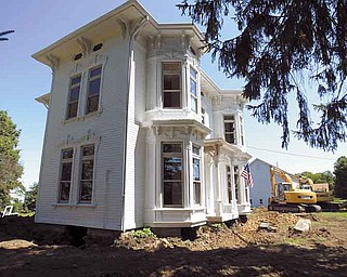 Crews are preparing to move an Italianate-style home owned by the Firestone family, known for its tire empire, just east on Lipply Road in view of Pine Lake. The house is currently next to the Firestone tire-testing facility.